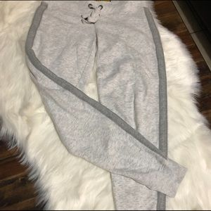 Light heathered grey joggers with charcoal stripe